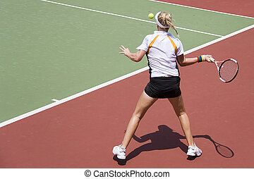 Junior Ladies Tennis - Junior ladies player in action at an...