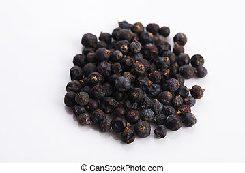 Juniper berries on white background