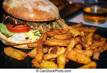Junk food concept. Hamburger with fries.