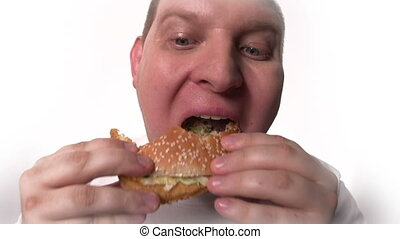 Junk Food Cravings - Fish eye close up of fat male face...