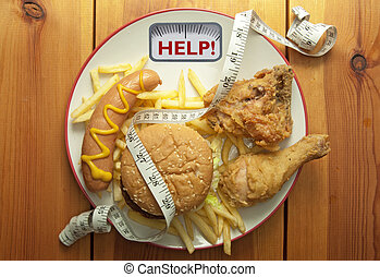 Junk food diet concept - Plate packed with junk food with ...