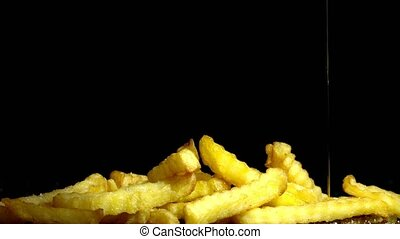Junk food - french fries - French fries on black background....
