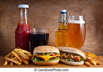 Junk food with burger, hotdog, french fries, cola, ketchup...