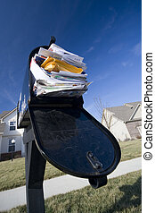 Junk mail - Mailbox full of junk mail with new houses and...