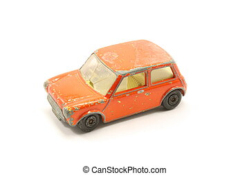 A toy compact car from the junkyard isolated on a white background.