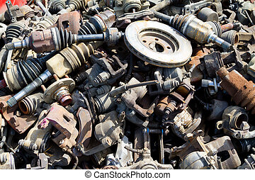 Abstract background color image of pieces at a junkyard auto salvage yard.