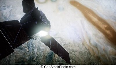 Juno sattelite orbiting Jupiter. Elements of this image ...