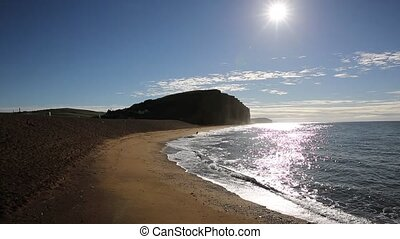 Jurassic coast Dorset at West Bay uk in morning with sun...