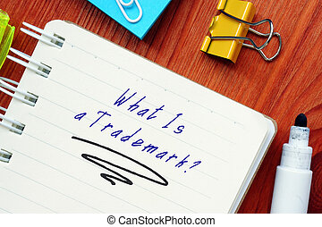 Juridical concept meaning What Is a Trademark? with inscription on the page.