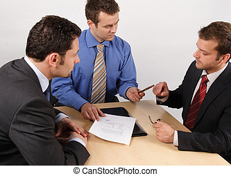 just before signing contract - business man giving a pen to...