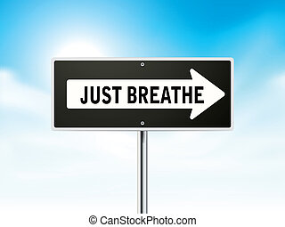 just breathe on black road sign isolated over sky