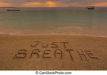 Just breathe words - In the picture a beach at sunset with...