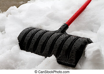 Just finished cleaning the sidewalk - Snow shovel laying on...