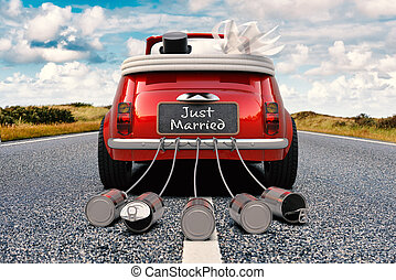 Just Married - A newlywed couple is driving a retro car with...