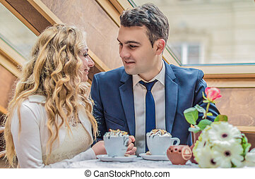 Just married couple in cafe