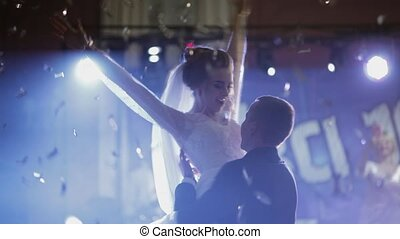 Just married couple is dancing at wedding party. Bride and...