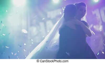 Just married couple is dancing at wedding party. Bride and groom dancing at wedding reception with friends and family