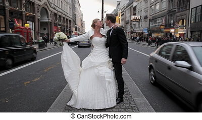 Just married couple kiss in London - Just married couple...