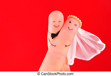 just married couple, newlyweds painted at fingers against ...