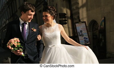 Just married couple walking in the city shot in slow motion...