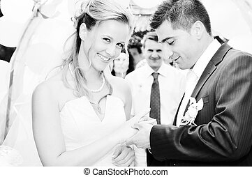 just married - happy young and beautiful bride and groom at...