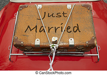 just married - Just Married written on a suitcase placed on...