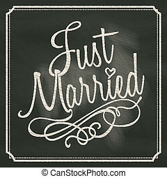 Just Married lettering sign on chalkboard background