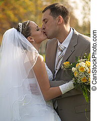 Just married portrait in park