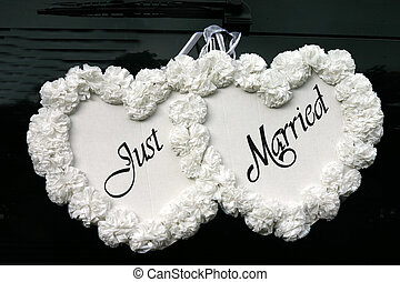 Just Married sign on the back of a car