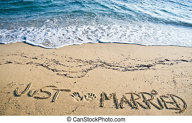 Just Married written in the Sand