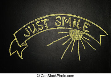 Just smile with Ribbon Banner, written with chalk on a blackboard