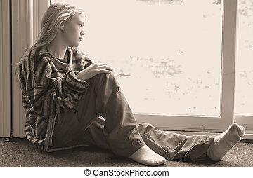 Just thinking - teen sitting alone thinking.