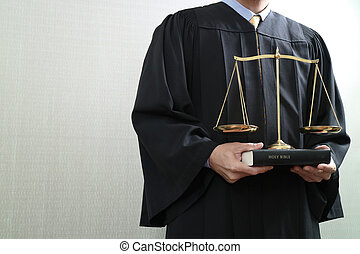 justice and law concept. Male judge in a courtroom with the balance scale and holy book