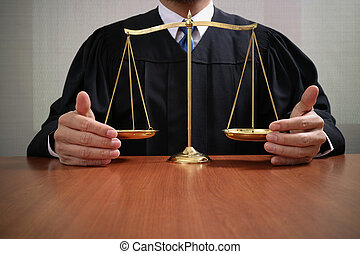 justice and law concept. Male judge in a courtroom with the balance scale on wood table