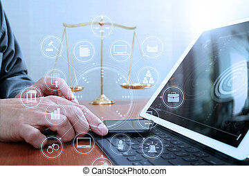 justice and law concept. Male lawyer in office with the balance brass scale, hand working with smart phone and digital tablet computer on wooden desk, virtual graphic icons screen diagram