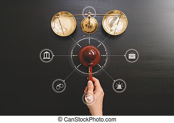 justice and law concept. Top view of Male judge hand in a courtroom with the gavel and brass scale on dark wood table with Vr diagram