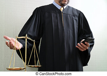 justice and law concept.Male judge in a courtroom with the balance scale and using smart phone