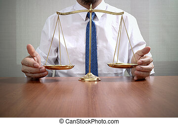 justice and law concept.Male lawyer in the office with brass scale on wooden table
