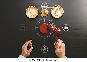 justice and law concept.Top view of Male judge hand in a courtroom with the gavel and brass scale on dark wood table with Vr diagram