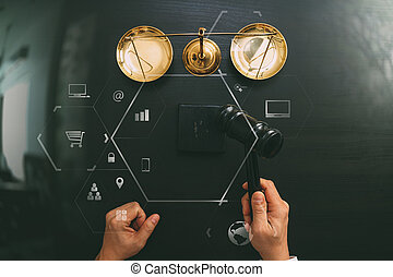 justice and law concept.Top view of Male judge hand in a courtroom with the gavel and brass scalr on dark wood table with Vr diagram