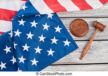 Justice gavel and American flag, top view.