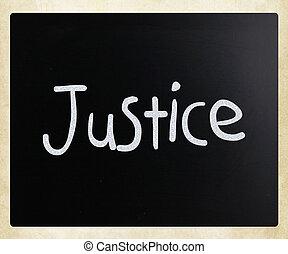 """Justice"" handwritten with white chalk on a blackboard"