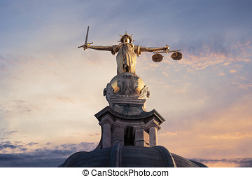 Justice On The Old Bailey, London with a sunset background