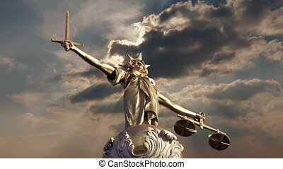 Justice Statue In Dramatic Sunlight - Statue of Lady Justice...