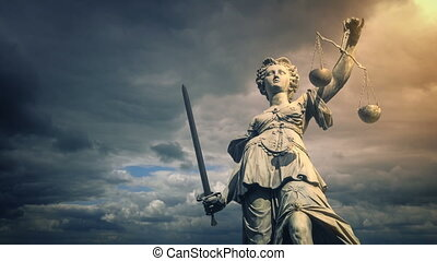 Statue of Lady Justice illuminated in the sun