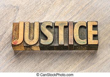 justice word in letterpress wood type
