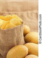 jute bag full of chips and raw potatoes