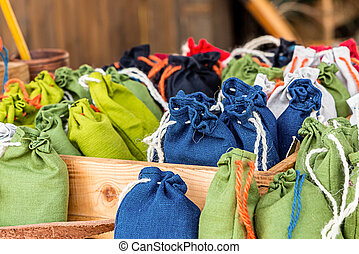 jute pouch of grass sachets natural eco materials. Blue small blue green bags close-up
