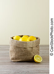 Jute sack of lemons, vertical