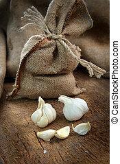 ripe garlic -  jute sack with ripe garlic  on wooden board